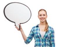Mujer joven sonriente con la burbuja en blanco del texto Fotografía de archivo libre de regalías