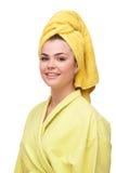 Mujer joven sonriente en albornoz y toalla Fotografía de archivo