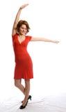 Mujer joven sonriente en alineada roja Fotografía de archivo libre de regalías