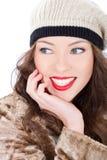 Mujer joven sonriente hermosa en una capa fotos de archivo libres de regalías