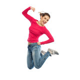 Mujer joven sonriente que salta en aire Foto de archivo