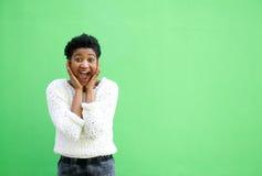 Mujer joven sorprendida con las manos en cara Foto de archivo libre de regalías