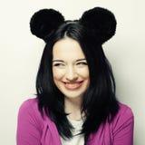 Mujer joven sorprendida con los oídos de ratón Fotografía de archivo libre de regalías