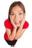 Mujer joven sorprendida emocionada alegre aislada Fotos de archivo