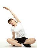 Mujer joven tranquila que hace ejercicios del deporte Fotografía de archivo libre de regalías
