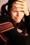 Mujer joven triste foto de archivo libre de regalías