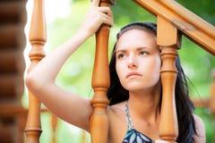 Mujer joven triste en la barandilla Foto de archivo libre de regalías