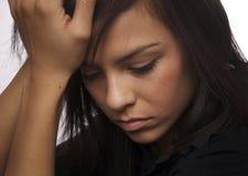 Mujer joven triste que mira abajo de (actuando) Fotos de archivo libres de regalías