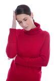 Mujer joven triste y triste aislada con dolor de cabeza o jaqueca Fotos de archivo