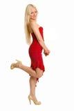 mujer joven vestida para arriba en rojo Imagen de archivo libre de regalías
