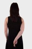 Mujer joven vista de detrás, sus manos detrás, ella Fotos de archivo libres de regalías