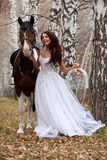 Mujer joven y caballo Foto de archivo libre de regalías