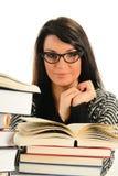 Mujer joven y libros aislados en blanco Imagen de archivo