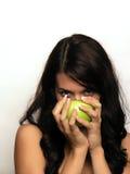 Mujer joven y manzana Fotografía de archivo