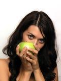 Mujer joven y manzana Imagen de archivo libre de regalías