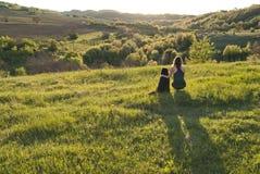 Mujer joven y su perro Fotografía de archivo libre de regalías