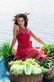 Mujer linda con las verduras en un barco Fotografía de archivo libre de regalías