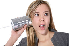 Mujer linda en el teléfono viejo Fotografía de archivo libre de regalías