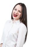 Mujer linda joven que muestra la lengua Fotografía de archivo libre de regalías