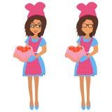 Mujer linda que sostiene la bandeja que cuece con el corazón grande de la torta y los pequeños corazones de las tortas Ilustració ilustración del vector