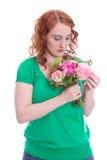 Mujer locamente enamorada en verde aislada en blanco Fotografía de archivo
