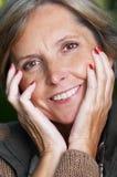 Mujer madura alegre Imagen de archivo
