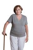 Mujer madura con el bastón Fotografía de archivo