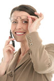 Mujer madura con el teléfono móvil Fotos de archivo libres de regalías