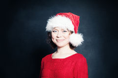 Mujer madura en Santa Hat Imagen de archivo