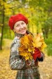 Mujer madura feliz en otoño Imágenes de archivo libres de regalías