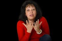 Mujer madura que discute emocionalmente foto de archivo libre de regalías