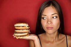 Mujer malsana de la comida basura Imagenes de archivo