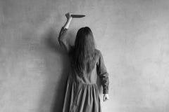 Mujer malvada con un cuchillo Imagen de archivo