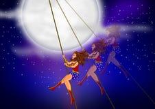 Mujer Maravilla en el cielo nocturno por completo de estrellas Fotos de archivo