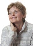 Mujer mayor agradable durante sesenta años fotografía de archivo libre de regalías