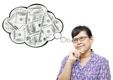 Mujer mayor asiática risueñamente y pensando al dinero Foto de archivo