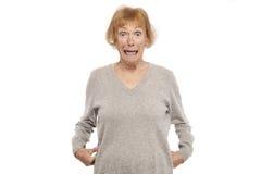 Mujer mayor chocada Foto de archivo libre de regalías