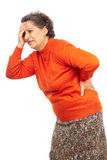 Mujer mayor con dolor de espalda Foto de archivo libre de regalías