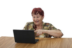 Mujer mayor con el cuaderno Imagen de archivo libre de regalías