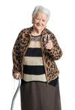 Mujer mayor con el vidrio de agua Foto de archivo