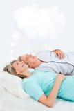 Mujer mayor con la burbuja del pensamiento Foto de archivo libre de regalías