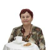 Mujer mayor con la taza de té Fotografía de archivo libre de regalías