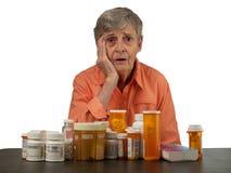 Mujer mayor con las medicaciones Fotografía de archivo libre de regalías