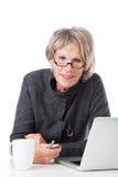 Mujer mayor con los vidrios Fotografía de archivo libre de regalías