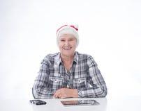 Mujer mayor con PC de la tableta Fotos de archivo libres de regalías