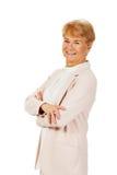 Mujer mayor de la sonrisa con las manos dobladas Imágenes de archivo libres de regalías