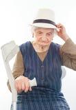 Mujer mayor discapacitada con la muleta dentro Fotos de archivo libres de regalías