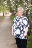Mujer mayor en el camino Fotografía de archivo libre de regalías