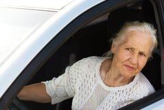 Mujer mayor en el coche Imágenes de archivo libres de regalías