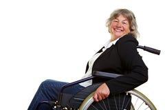 Mujer mayor en sillón de ruedas fotografía de archivo libre de regalías
